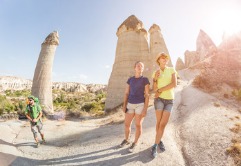 Multicultural friends travel and having fun at old ancient Zelve town in Cappadocia, Turkey