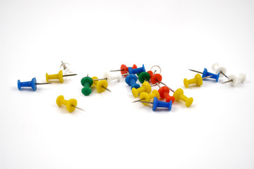 Tacks stock images. Tack on a white background. Multicolor plastic tacks. Set of color pins