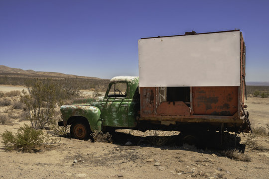 Old truck with blank signboard