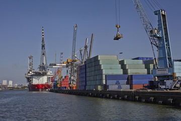 big container ships with cranes in the harbor of rotterdam