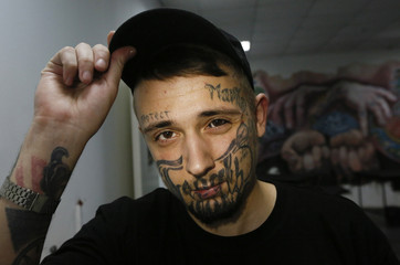 Managing director of a tattoo studio Nikolay Markelov poses for a picture in Krasnoyarsk