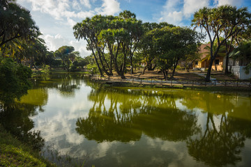 Picturesque landscape with reflections in  green river, Kenya