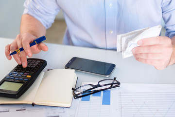 Hand man doing finances and accounting about cost at home office.Concept finances and economy