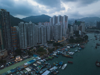 Aerial Top View of The Aberdeen Bay and the buildings on two sides of the harbour in Hong Kong.