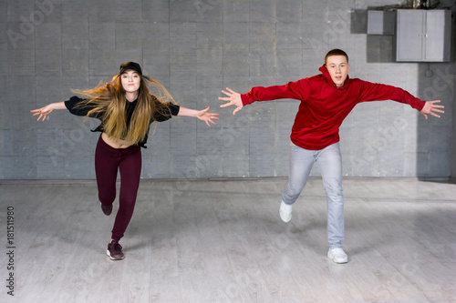 guy and girl in dance movement modern style young dancers