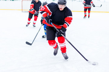 Ice hockey skater with stick in counterattack.
