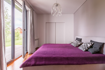 Cozy bedroom with balcony