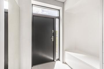 White entryway with gray door