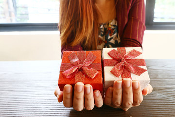 Gifts box on women 's hand,Christmas concept.