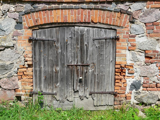 Old wooden door in Masuria in Poland
