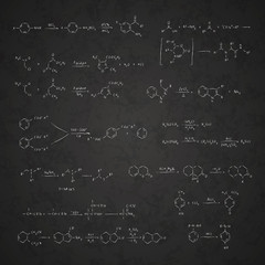 Set of chemical reaction equations and formulas on school blackboard