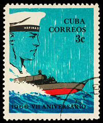 Sailor and motorboat on postage stamp
