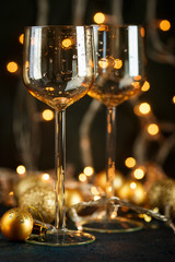 Glasses for wine and golden Christmas balls