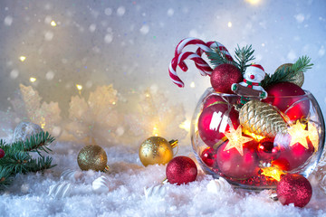 Foto op Canvas Kerstmis Christmas or New year bright decoration in glass vase with candy canes on snow background