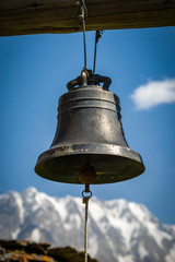 Bell in the yard of the church in the mountains. Travelling in the Caucasian Mountains.