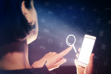 Image of a girl with a smartphone in hands. She presses on the search icon. Online search concept.