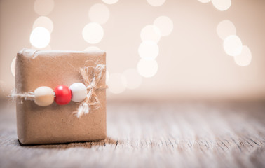 Small handmade gift boxes in shiny lights background and space for text