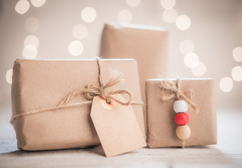 Gift boxes with tag on bokeh background