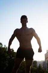 Bodybuilder showing muscular body