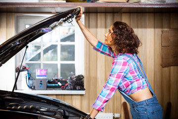 beautiful woman mechanic in a garage