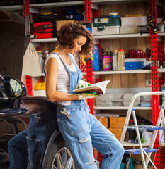 woman car mechanic in the garage