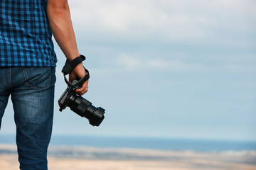 Professional camera in man's hand