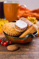 Autumn dessert, stuffed cookies on the wooden table, Thanksgiving food concept