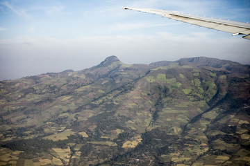 Aerial view of farms and mountains in Ethiopia taken from a plane.