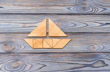 puzzle in the form of a boat on a wooden background