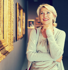 Portrait of adult woman near picture collection