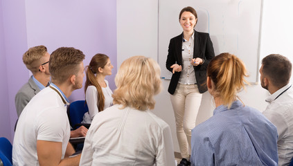 Female speaker giving presentation for students in lecture hall