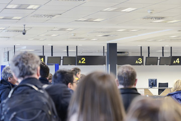 group of people awaiting registration at the airport building