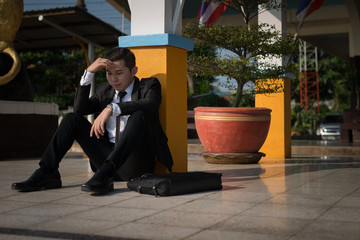 Young asian businessman feel stressed/worry/headache/disappoint during working, unemployment, fired from job, disappointed, loss and feeling down concept