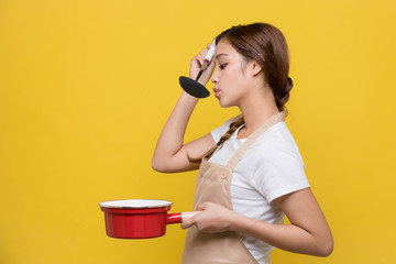Young woman tasting her dish.