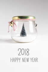 2018 Happy New Year message with Christmas tree in a glass Jar