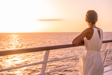 Cruise ship luxury travel holiday destination woman on Europe summer vacation. Elegant lady relaxing on outdoor deck looking at view of Mediterranean Sea.