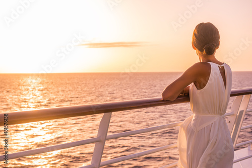 Wall mural Cruise ship luxury travel holiday destination woman on Europe summer vacation. Elegant lady relaxing on outdoor deck looking at view of Mediterranean Sea.
