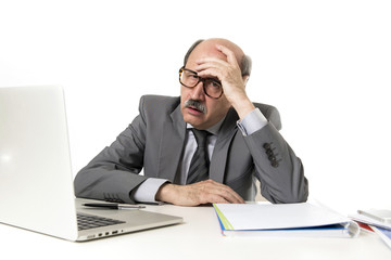 mature business man with bald head on his 60s working stressed and frustrated at office computer laptop desk looking tired
