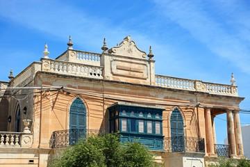 Traditional Maltese building with balconies, Marsaxlokk, Malta.