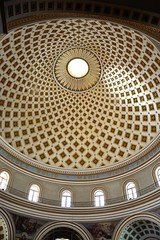 The patterned domed ceiling inside the Rotunda of Mosta, Malta.