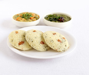 Rava idli or semolina cake, which is steam-cooked, is a traditional and popular south Indian vegetarian food.
