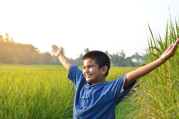 Happy little farmer on rice field