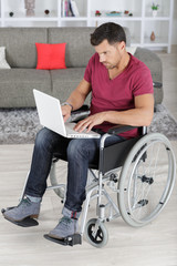 young disabled businessman working from home
