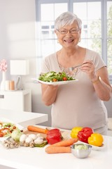 Modern grandmother eating healthy