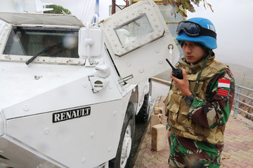 A U.N. peacekeeper patrols near the Lebanese-Israeli border as seen in southern village of  Adaisseh, Lebanon