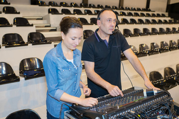 female and male sound mixer on a city festival