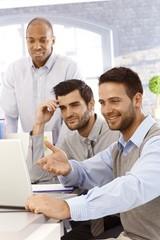 Happy businessmen working together
