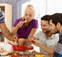 Friends having cheese fondue