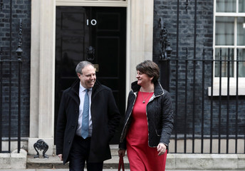 Arlene Foster, leader of the Democratic Unionist Party (DUP), and her deputy Nigel Dodds leave 10 Downing Street, London