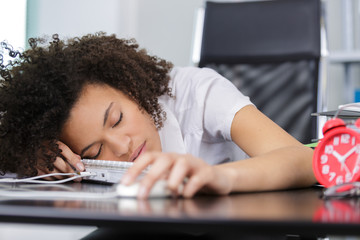 young office worker sleeping